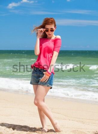 Fotó gyönyörű fiatal nő áll part megnyugtató Stock fotó © Massonforstock