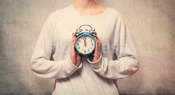 beautiful young woman hands holding a cute alarm clock on the wo Stock photo © Massonforstock