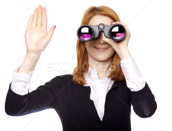 Business women seeking with binocular and show right hand. Studio shot. Stock photo © Massonforstock
