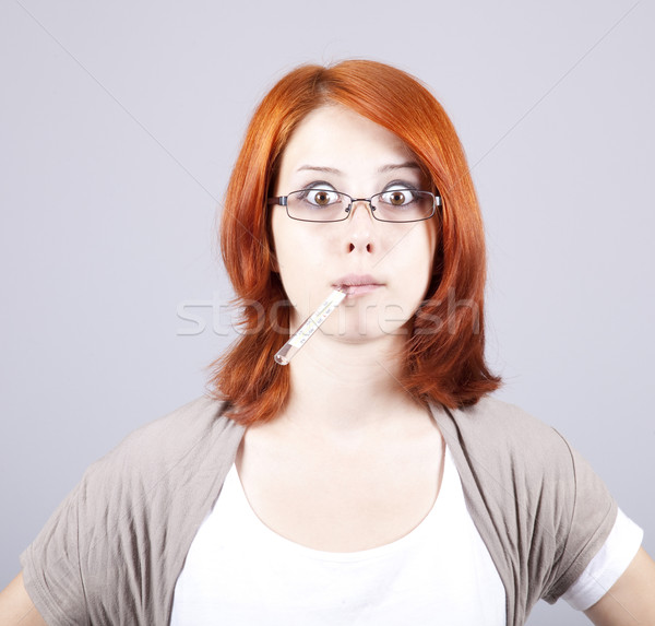 Young businesswomen with thermometer in mouth Stock photo © Massonforstock