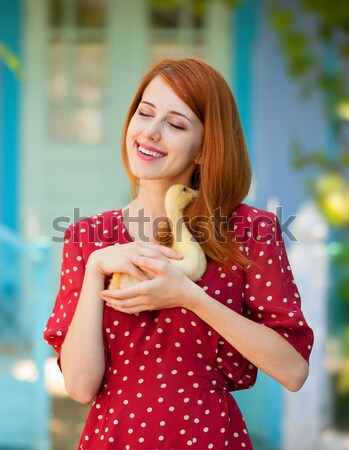 Shopping girl in violet with bags. Stock photo © Massonforstock