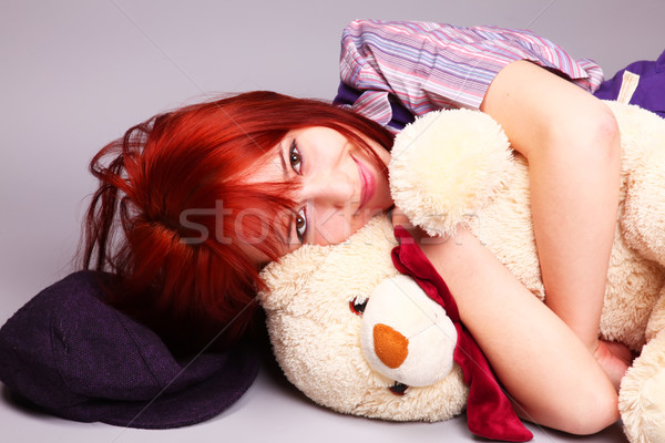 Beautiful girl sleeping with teddy bear at St. Valentine's Day  Stock photo © Massonforstock
