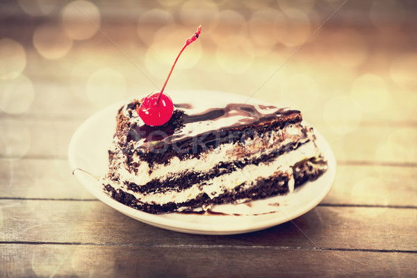 Cherry cake. Photo in old vintage color image style. Focus on ch Stock photo © Massonforstock