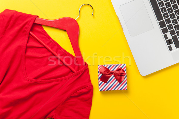 Gift box and dress with laptop computer  Stock photo © Massonforstock