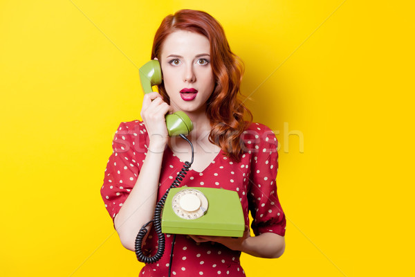 girl in red dress with green dial phone  Stock photo © Massonforstock