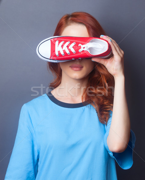 girl in blue dress with red gumshoe Stock photo © Massonforstock
