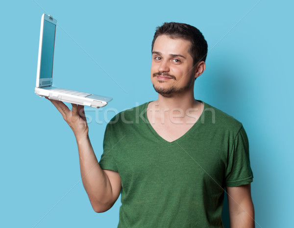 Guy tshirt ordinateur portable jeunes bleu mains Photo stock © Massonforstock