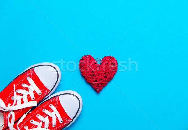 big red gumshoes and beautiful heart shaped toy on the wonderful Stock photo © Massonforstock