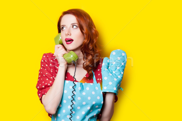 beautiful young woman with retro phone on the wonderful yellow b Stock photo © Massonforstock