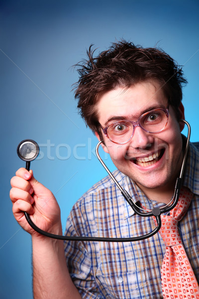 Funny M.D. with statoscope  Stock photo © Massonforstock