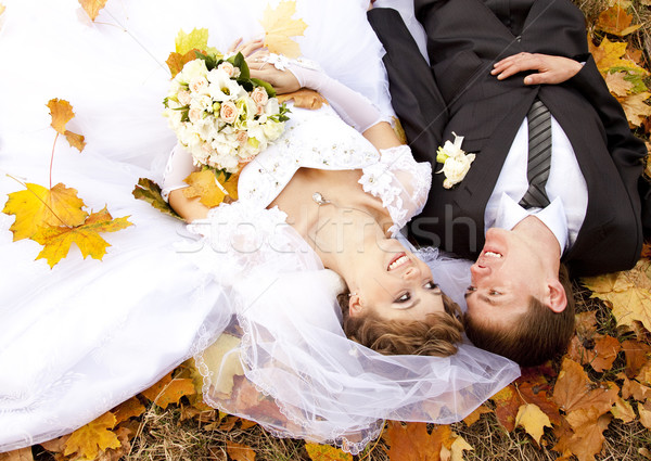 Stock photo: Couple liying down at the park