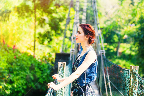 Young woman standing on a bridge  Stock photo © Massonforstock
