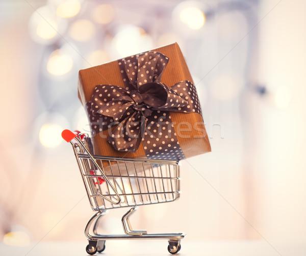 Christmas gift box and shopping cart  Stock photo © Massonforstock