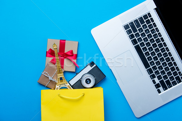 eiffel tower shaped toy, camera and gifts in shopping bag and co Stock photo © Massonforstock