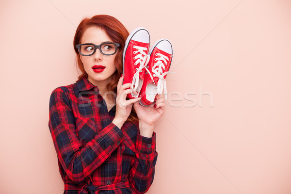 beautiful young woman with red gumshoes on the wonderful pink ba Stock photo © Massonforstock