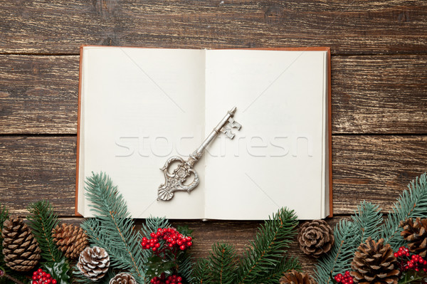 photo of opened notebook and silver key near christmas decoratio Stock photo © Massonforstock