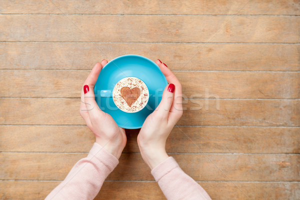 photo of female hands holding cup of coffee on the wonderful bro Stock photo © Massonforstock