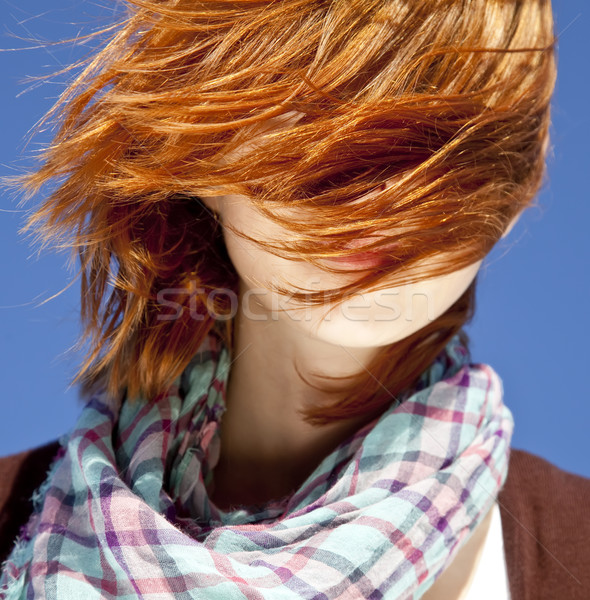 Portrait of red-haired girl with scarf on blue background. Stock photo © Massonforstock