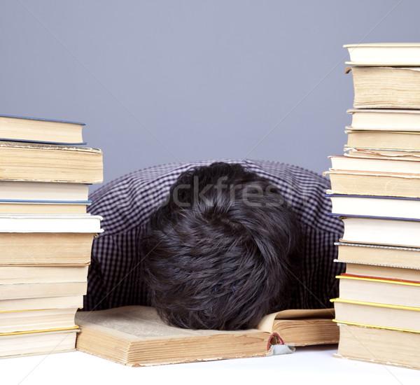 Jonge moe student boeken geïsoleerd Stockfoto © Massonforstock