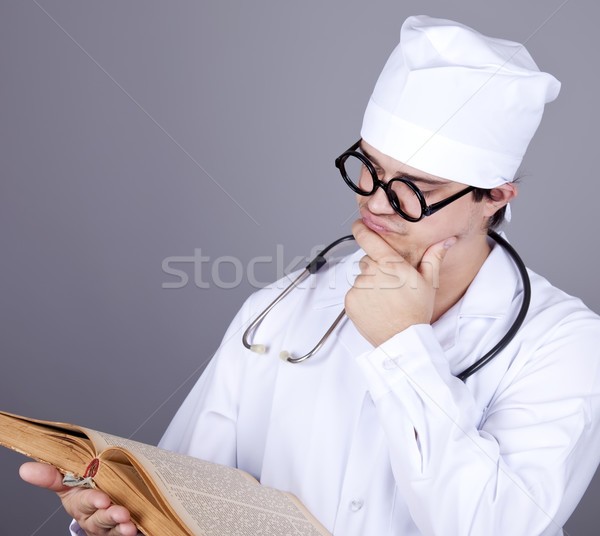 Young doctor with book. Stock photo © Massonforstock