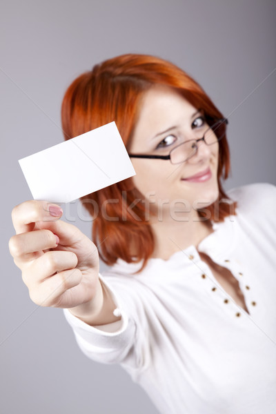 Portrait of an young beautiful happy woman with blank white card Stock photo © Massonforstock