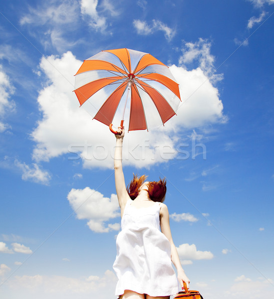 Redhead enchantress with umbrella and suitcase at spring  Stock photo © Massonforstock