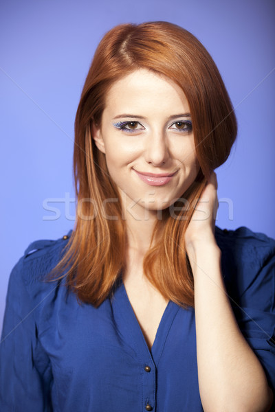 Portrait of beautiful redhead girl with style make-up. Stock photo © Massonforstock