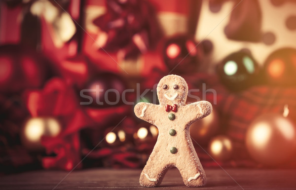 Cookie man and christmas gifts Stock photo © Massonforstock