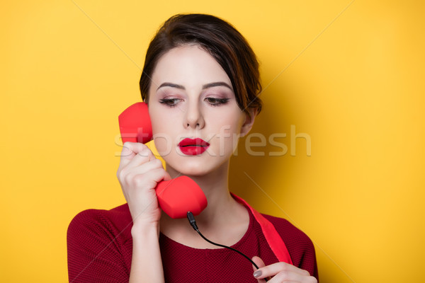 young housewife with red handset  Stock photo © Massonforstock