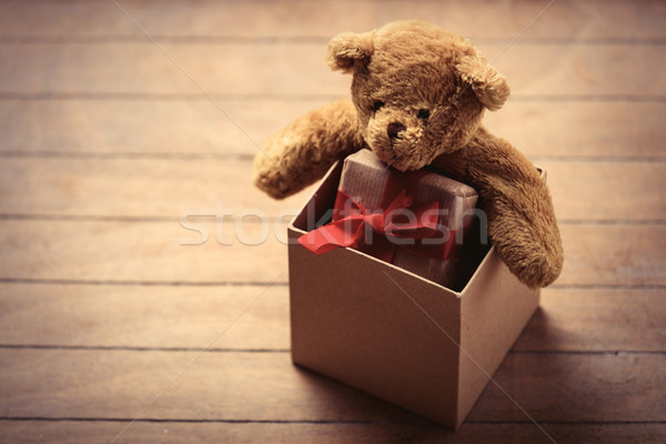 teddy bear and gift in box Stock photo © Massonforstock