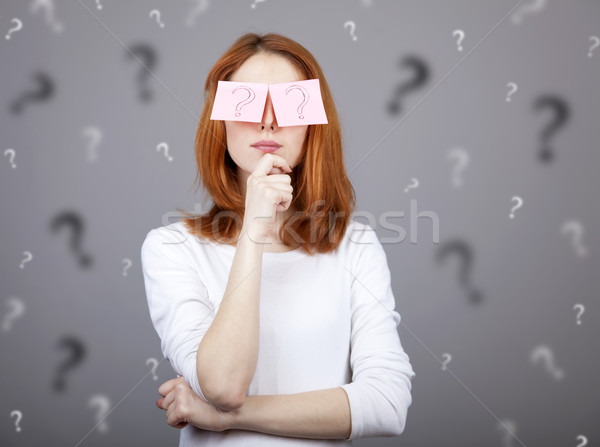 Portrait of red-haired girl with colorful funny stickers on eyes Stock photo © Massonforstock