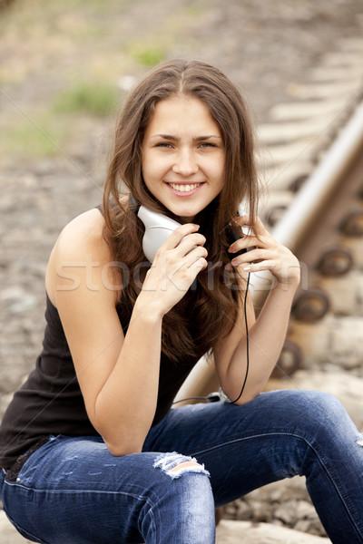Teen girl with headphones at railways. Stock photo © Massonforstock