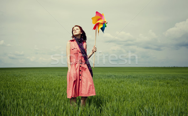 Young women with toy wind turbine at green wheat field. Stock photo © Massonforstock