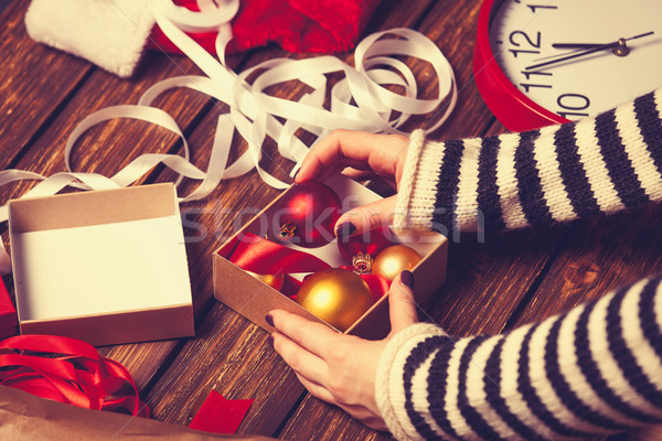 Female hands and christmas gift Stock photo © Massonforstock