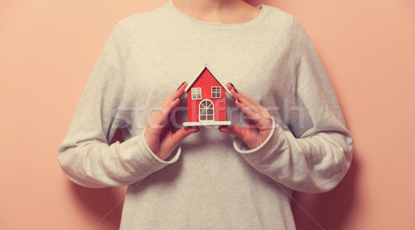 Woman holding a toy house  Stock photo © Massonforstock
