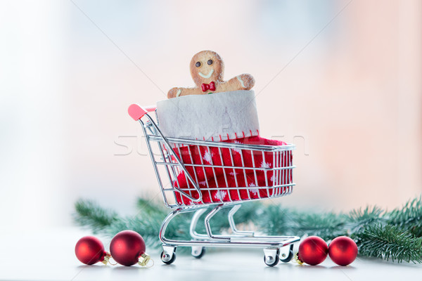 Christmas cookie and sock in shopping cart  Stock photo © Massonforstock