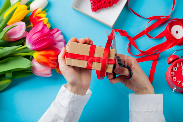white caucasian female hands wrapping gift near things for decor Stock photo © Massonforstock