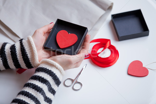 white caucasian hands holding heart shaped toy in box on the won Stock photo © Massonforstock