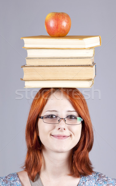 Meisje appel boeken hoofd school vruchten Stockfoto © Massonforstock