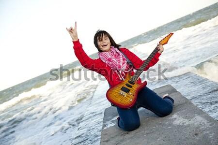 Csinos fiatal nő gitár tengerpart zene lány Stock fotó © Massonforstock