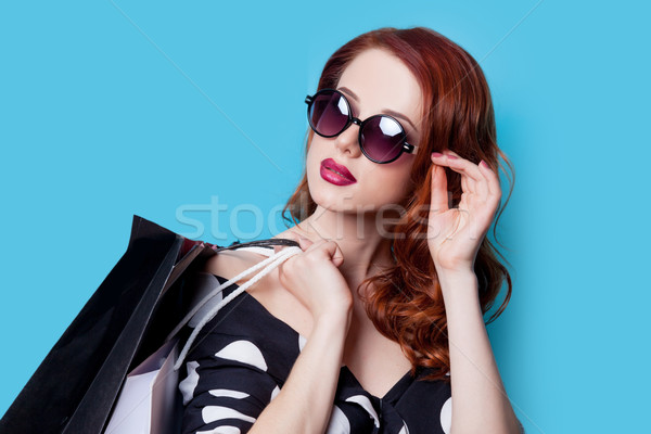girl in black dress with shopping bags Stock photo © Massonforstock