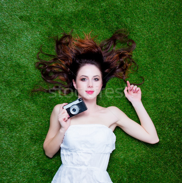 Portrait of a young redhead woman with vintage camera  Stock photo © Massonforstock