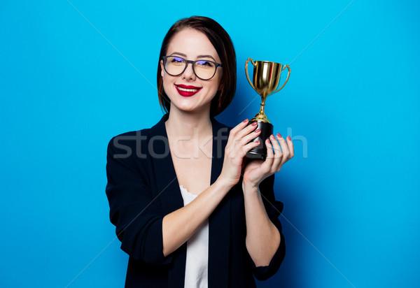 Jonge glimlachende vrouw beker trofee portret mooie Stockfoto © Massonforstock