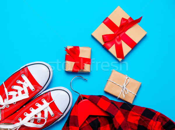 beautiful gifts of different sizes and colors, red gumshoes and  Stock photo © Massonforstock