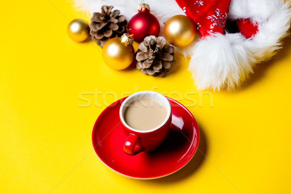 beautiful cup of coffee on plate and Christmas decorations on th Stock photo © Massonforstock