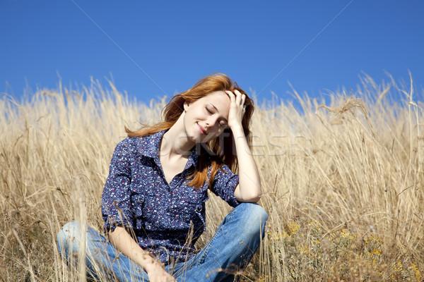 Portre mutlu kız sonbahar çim yüz Stok fotoğraf © Massonforstock