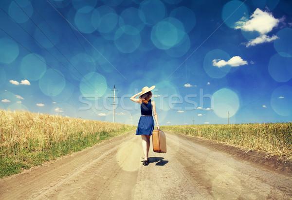 Eenzaam meisje koffer foto bokeh Stockfoto © Massonforstock