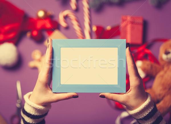 Feminino mãos azul photo frame natal Foto stock © Massonforstock