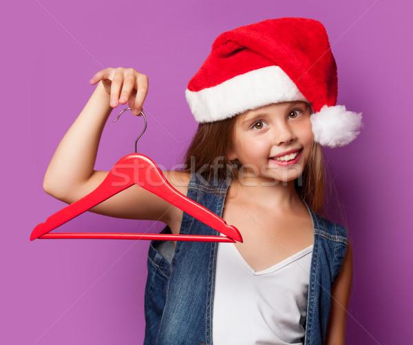 girl in red Santas hat with hanger Stock photo © Massonforstock