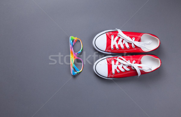 red gumshoes and glasses  Stock photo © Massonforstock